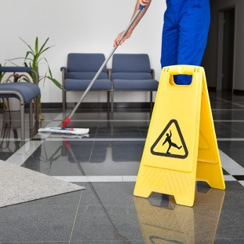Person Cleaning the Floor